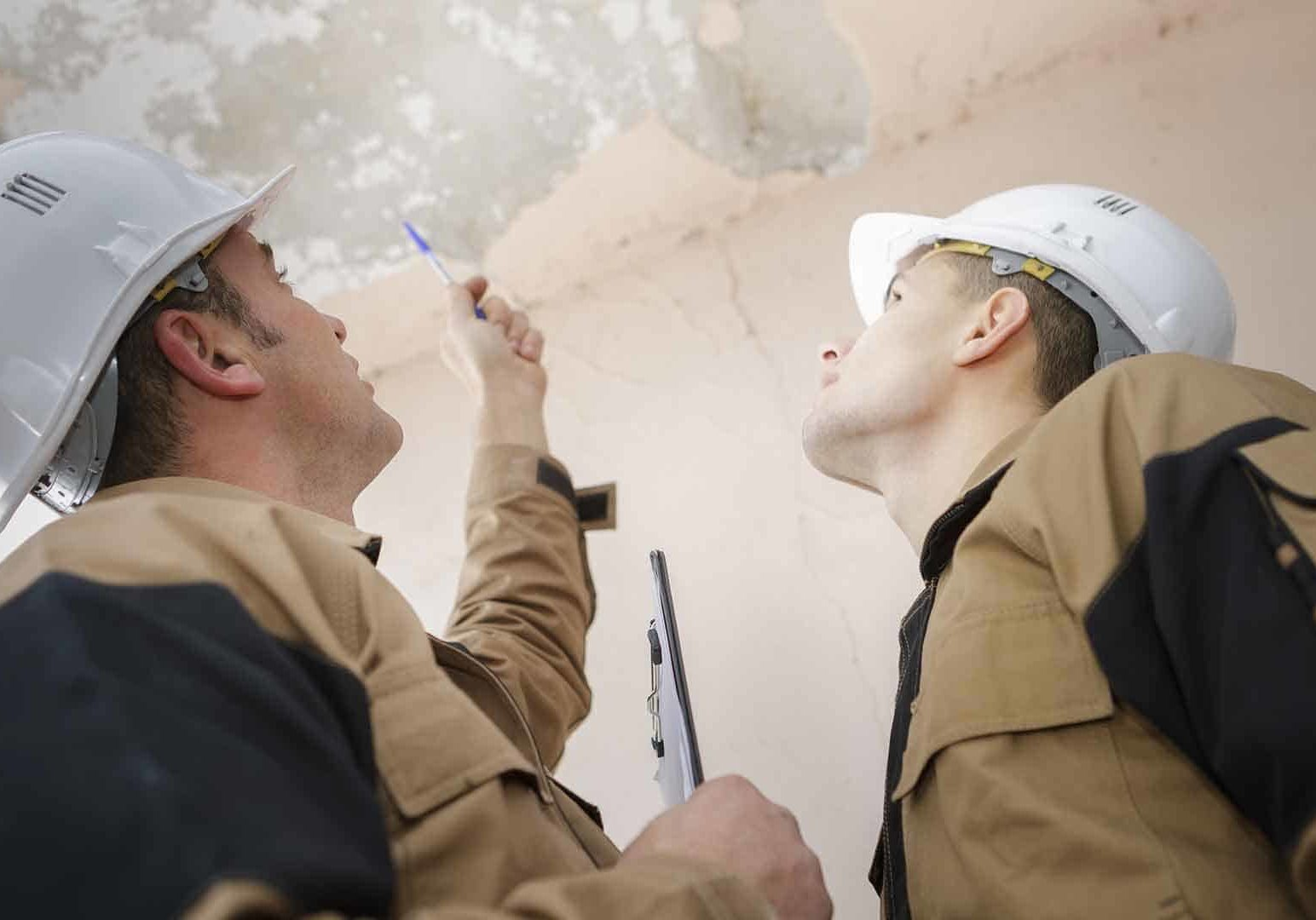 construction workers reviewing damage